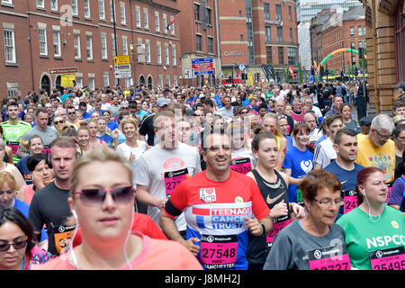 Runners and athletes take part in the 2017 Simplyhealth Great Manchester Run half marathon and 10k run - Stock Photo
