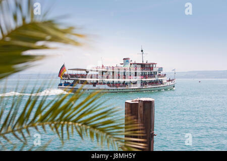 Excursion boat leaves, port of Meersburg, Lake Constance. - Stock Photo