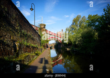 Sunny day, victorian cast iron railway bridges  Castlefield on the Rochdale Canal, Gtr Manchester, UK. - Stock Photo