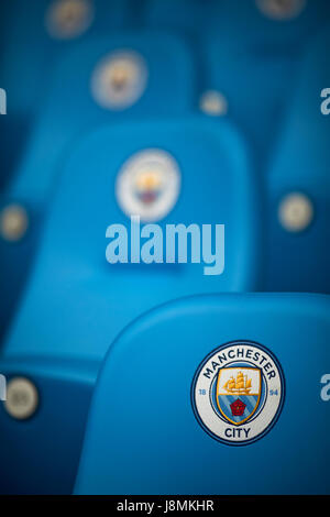 Manchester City Etihad Stadium  posh seats with round logo. - Stock Photo