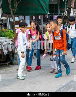 Yantou, Yongjia, Zhejiang, China.  Children Walking Home after School. - Stock Photo