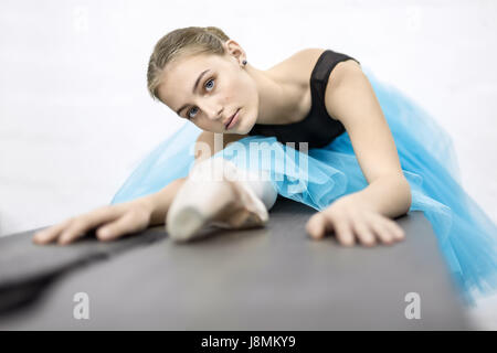 Ballerina posing in studio - Stock Photo