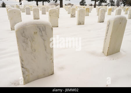 Snow covered the ground and tops of markers where military veterans are buried at Little Big Horn - Stock Photo