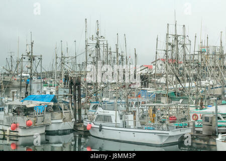 Commercial fish boats stay in port on an overcast winter day at French Creek, near Parksville on Vancouver Island, - Stock Photo