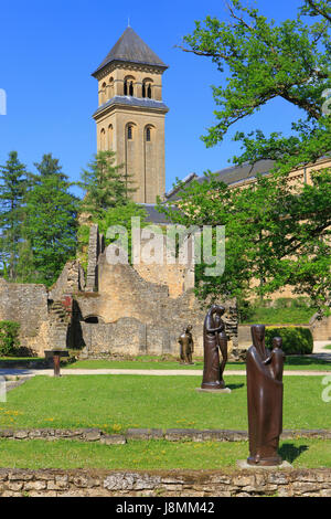 The bell-tower of Orval Church (1948) amidst the 12th-century ruins of the old Cathedral of Orval Abbey in Villers - Stock Photo