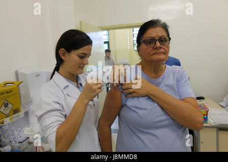 Annual vaccination campaign against influenza in a public health office at Sao Paulo city. This year with three - Stock Photo