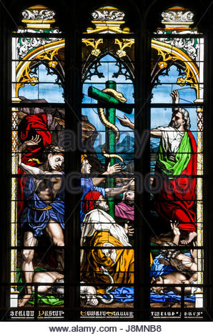 Stained glass window depicting Moses and the serpent, West window, Norwich Cathedral, England, UK - Stock Photo