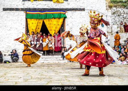 This ancient ritual mask dance also known as Cham is performed at religious festivals known as tsechu in Bhutan - Stock Photo