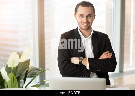 Confident businessman posing at workplace