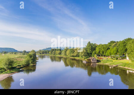River Weser and old wooden mill near Minden, Germany - Stock Photo