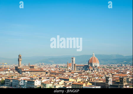 Scenic skyline view of Florence, Italy dominated by the terra-cotta dome of the Cattedrale di Santa Maria del Fiore - Stock Photo