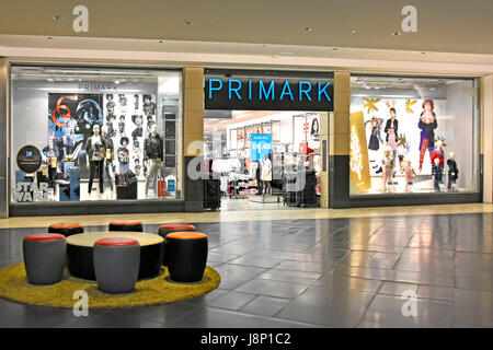 Early morning view of a quiet Primark store entrance in Intu indoor shopping mall Lakeside shopping centre Thurrock - Stock Photo