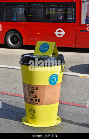 Coffee cup special litter trash bin to recycle paper coffee cups in yellow bins on pavement City of London England - Stock Photo