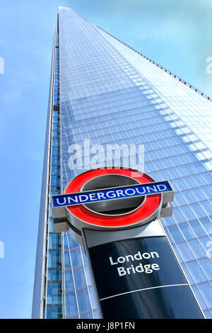London Bridge underground station roundel sign in front of Shard landmark skyscraper all part of the London Bridge - Stock Photo