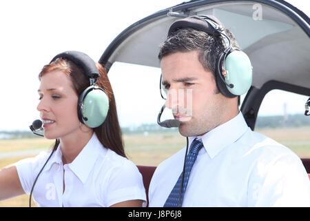 woman, female, flight, male, masculine, headset, aircraft, aeroplane, plane, - Stock Photo