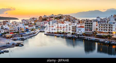 View of Agios Nikolaos and its harbor, Crete, Greece. - Stock Photo