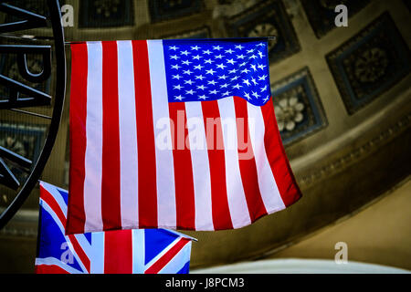 American flag with Union Jack on background - Stock Photo