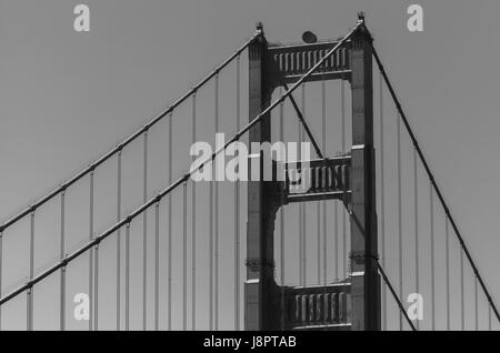A close up shot at the structures of the iconic Golden Gate Bridge in San Francisco, USA - Stock Photo