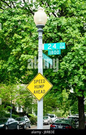 'Speed hump ahead' sign on lamp post in Washington DC, USA - Stock Photo
