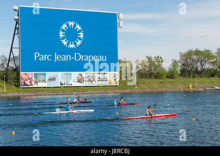 Montreal, CA - 29 May 2017: Kayakers in front of Parc Jean Drapeau sign - Stock Photo