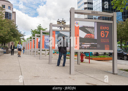 Montreal, CA - 27 May 2017:  Outdoor exhibition on McGill College Avenue celebrating Expo 67 50th anniversary - Stock Photo