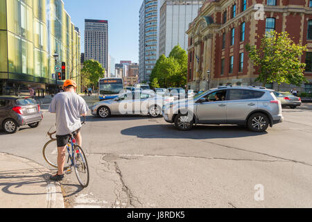 Montreal, CA - 27 May 2017: Traffic on Sherbrooke street on a sunny day - Stock Photo