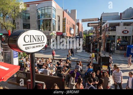 Montreal, CA - 27 May 2017: St-Denis street is turned into a pedestrain zone during 'Terrasses au Quartier Latin' - Stock Photo