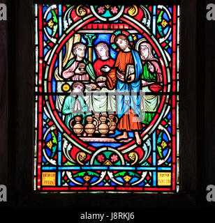Scene from Life of Jesus, by Adolph Didron, Paris, 1860, stained glass window, Feltwell, Norfolk. Jesus at Cana - Stock Photo