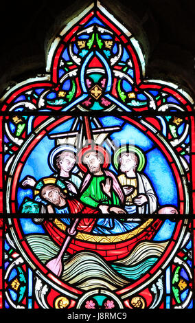 Scene from Life of Jesus, by Adolph Didron, Paris, 1860, stained glass window, Feltwell, Norfolk. Jesus sleeps in - Stock Photo