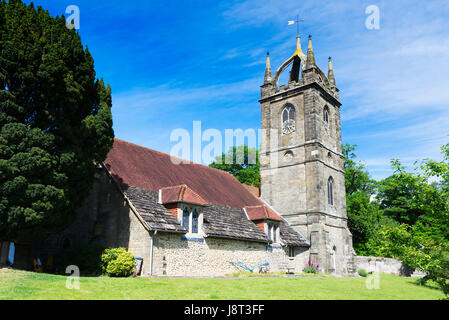 The Church of All Hallows in the village of Tillington near Petworth on a bright spring morning, West Sussex, UK - Stock Photo