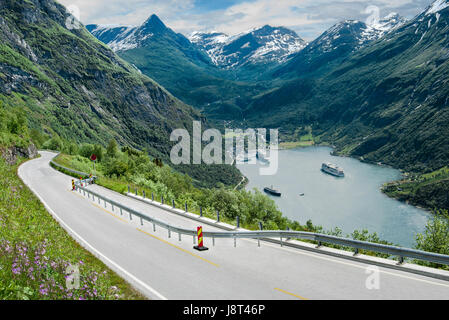 Fjord Road in Norway:  A two-lane road narrows as it descends beside Geirangerfjord in the mountains of southwest - Stock Photo