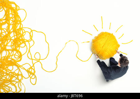 Concept of solution and innovation with wool ball - Stock Photo