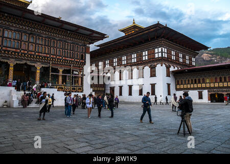 Visitors at the main courtyard or Utse of Tashichho Dzong in Thimphu, Bhutan. - Stock Photo