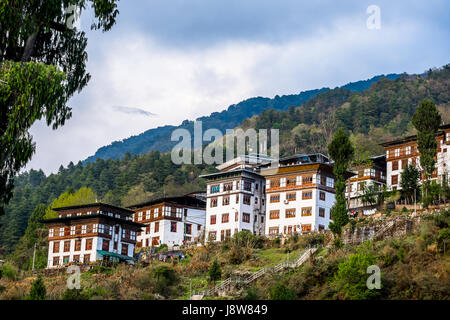 Bhutanese residential apartment at Trongsa, central Bhutan. - Stock Photo