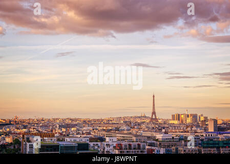 Aerial scenic view of Paris with the Eiffel tower at sunset, Montmartre in the background, France and Europe city - Stock Photo