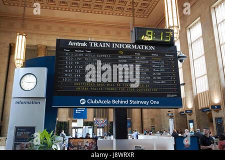 amtrak train information board in main waiting room inside septa 30th street train station Philadelphia USA