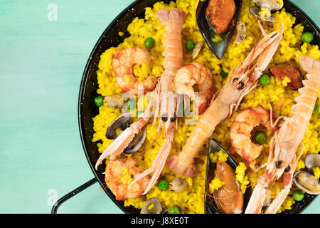 Closeup of Spanish seafood paella in paellera with copyspace - Stock Photo