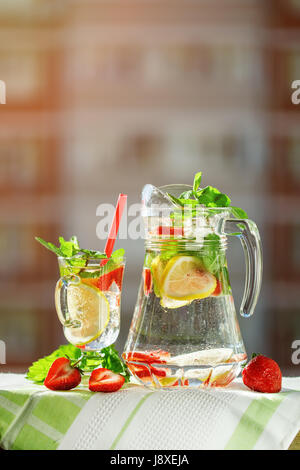 Fresh summer healthy drink with lemon and strawberries with ice. - Stock Photo