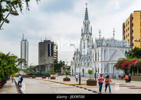 Cali, Colombia - February 6, 2014: People in a street in front of the La Ermita Church in city of Cali, Colombia - Stock Photo