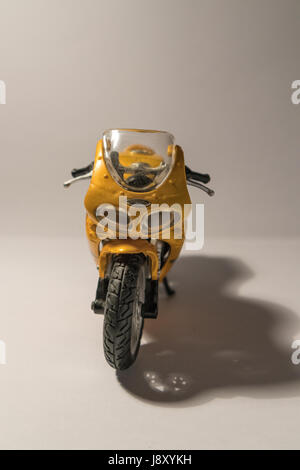 Miniature yellow sport motorbike, isolated on white background - Stock Photo