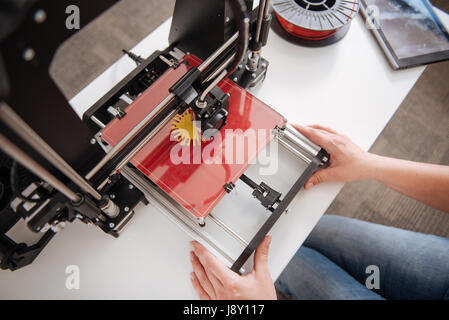 Top view of a 3d printer being in use - Stock Photo