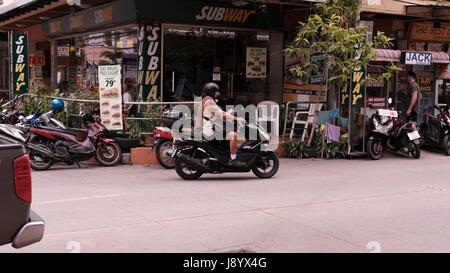 Motor Bikes in Traffic at Soi Buakhao and Soi Diana Pattaya Thailand's Most Dangerous Intersection on a gloomy overcast - Stock Photo