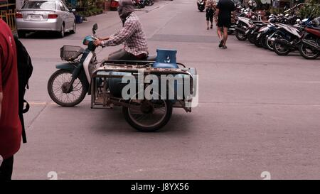 Sidecar Motor Bikes in Traffic at Soi Buakhao and Soi Diana Pattaya Thailand's Most Dangerous Intersection on a - Stock Photo