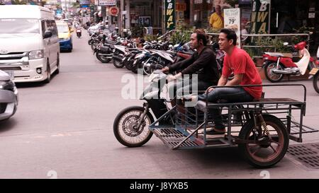 Sidecar Motor Bikes with Passenger in Traffic at Soi Buakhao and Soi Diana Pattaya Thailand's Most Dangerous Intersection - Stock Photo
