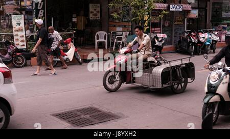 Tricycle Motor Bike with sidecar in Traffic at Soi Buakhao and Soi Diana Pattaya Thailand's Most Dangerous Intersection - Stock Photo