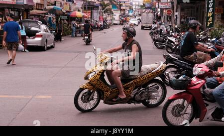 traveller on a Motor Bike in Traffic at Soi Buakhao and Soi Diana Pattaya Thailand's Most Dangerous Intersection - Stock Photo