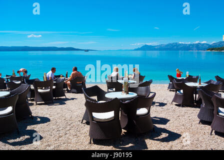 Bounty, cafe terrace, Plaza Donja Luka, the main beach, Makarska, Dalmatia, Croatia - Stock Photo