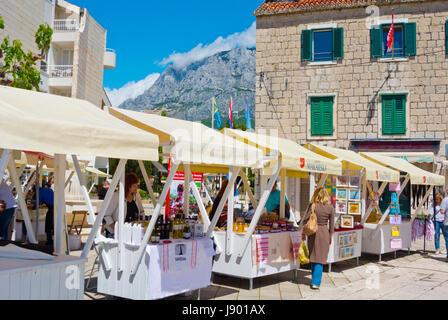 Market stall, producers selling local products, Obala kralja Tomislava, seaside promenade, Makarska, Dalmatia, Croatia - Stock Photo