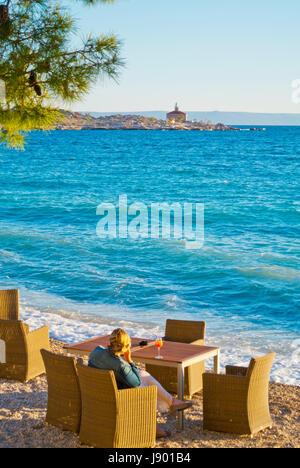 Bar terrace, Plaza Donja Luka, main beach, Makarska, Dalmatia, Croatia - Stock Photo