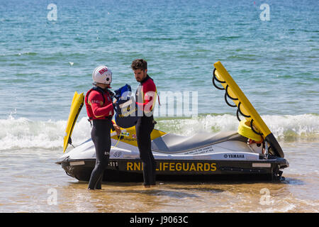 RNLI Lifeguards and jetski at Bournemouth beach seaside, Bournemouth, Dorset in May - Stock Photo